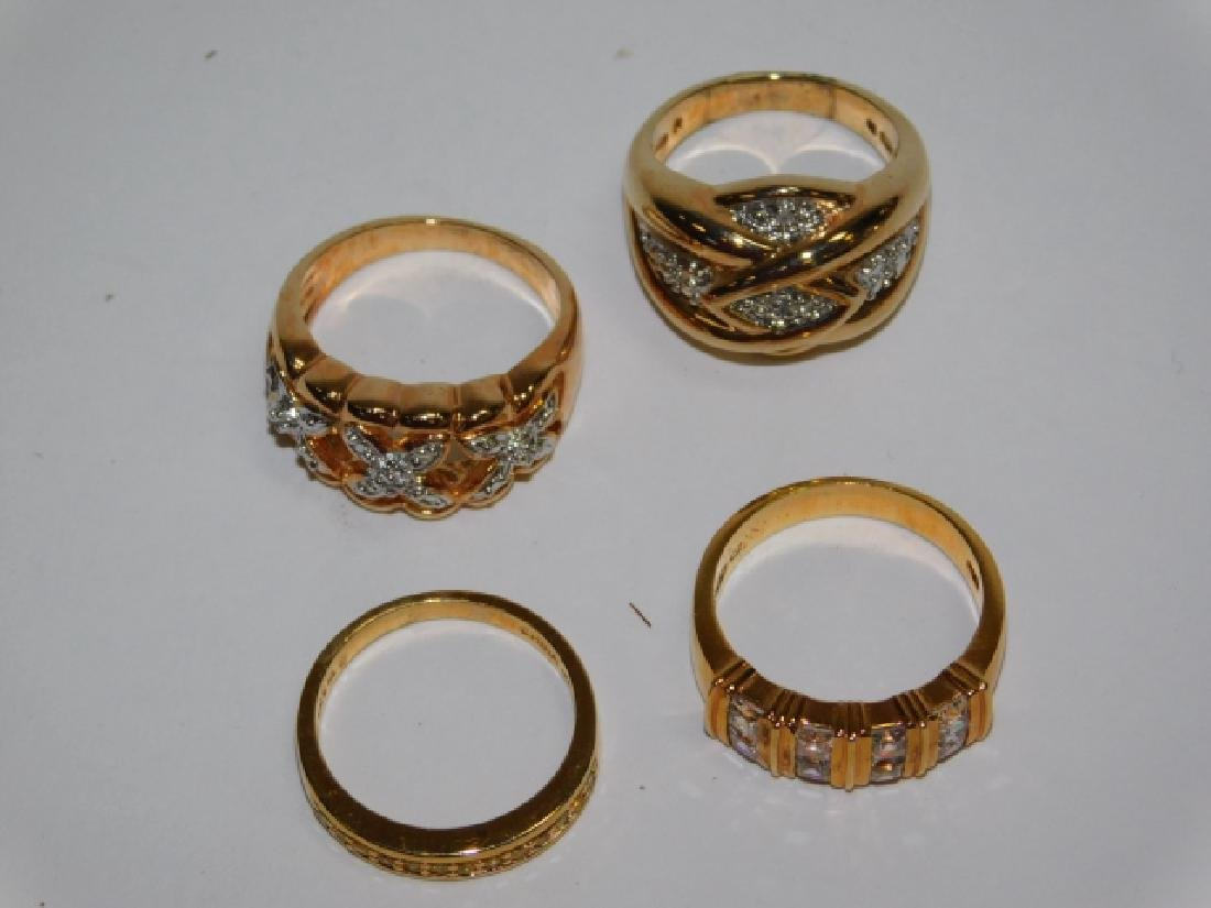 FOUR STERLING SILVER RINGS - 2