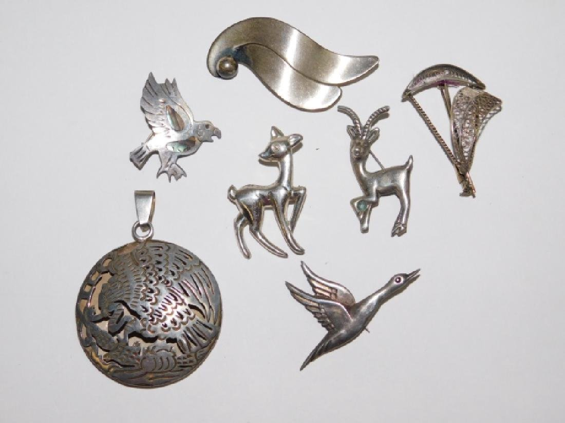 SEVEN STERLING SILVER PINS AND PENDANT