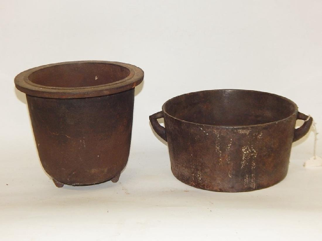 TWO CAST IRON COOKING POTS