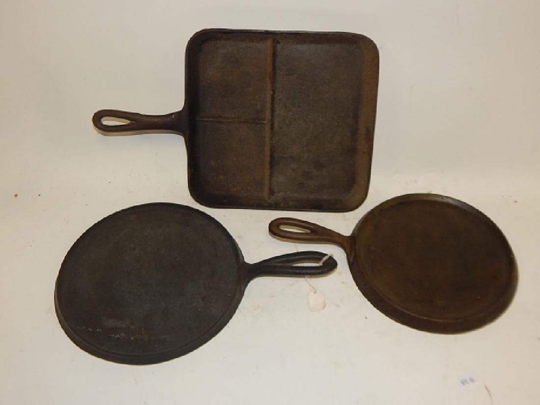 THREE CAST IRON PANS