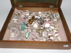 LOT OF GLASS BOTTLE STOPPERS AND WOODEN BOX