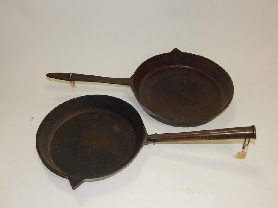 TWO CAST IRON FRYING PANS