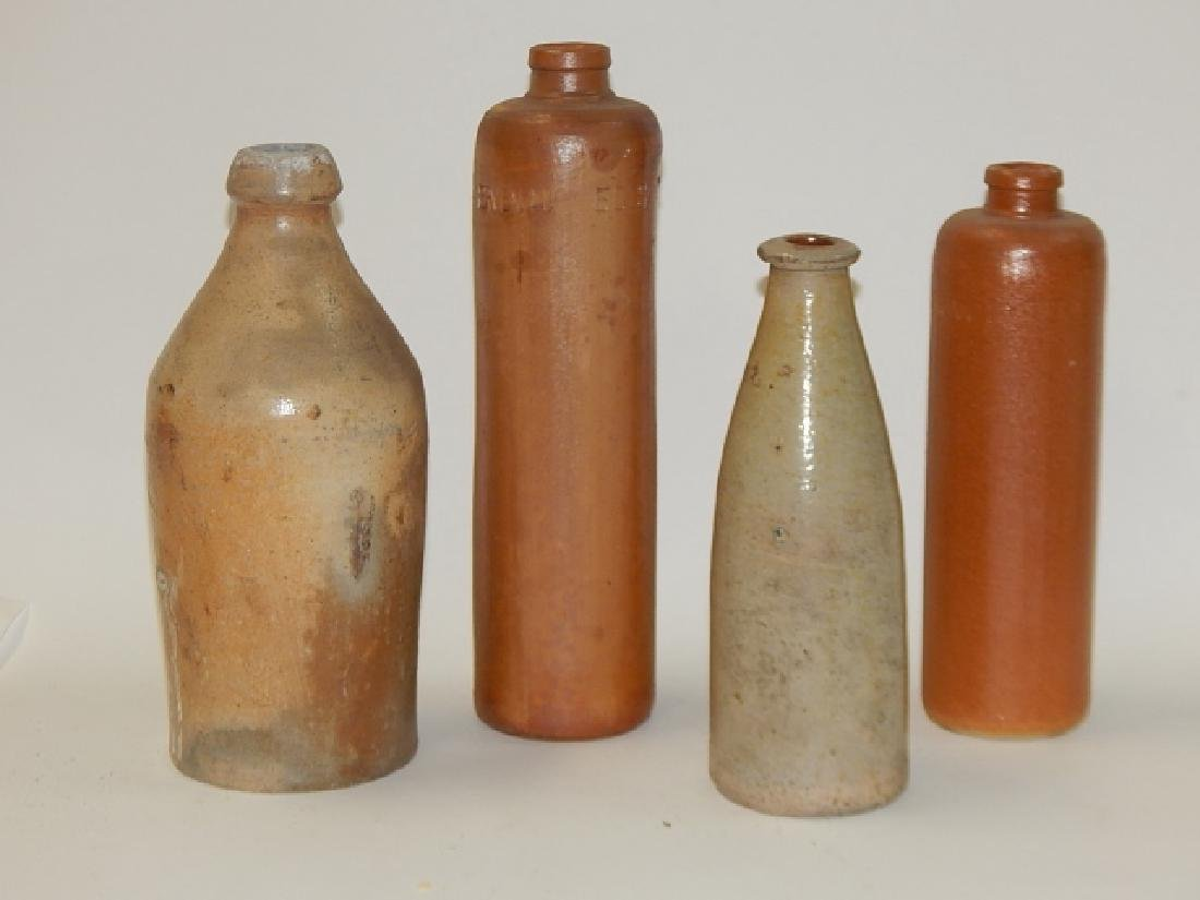 FOUR STONEWARE BOTTLES