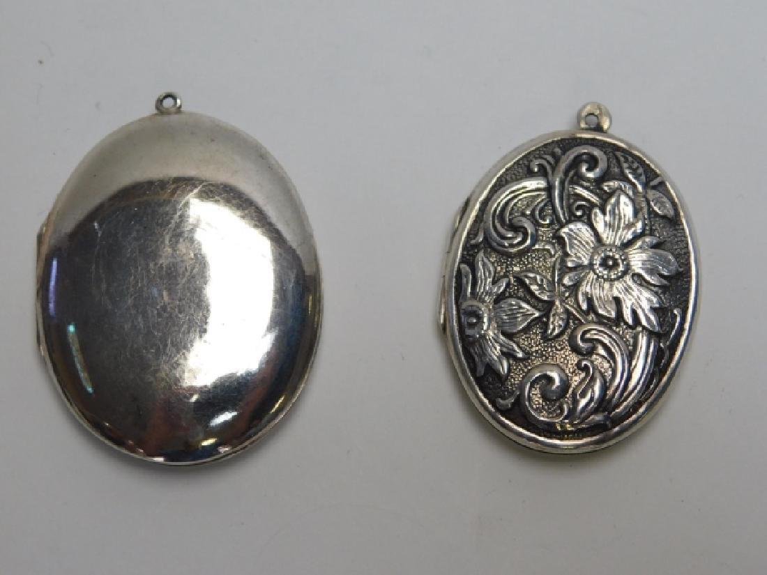 TWO STERLING SILVER LOCKETS