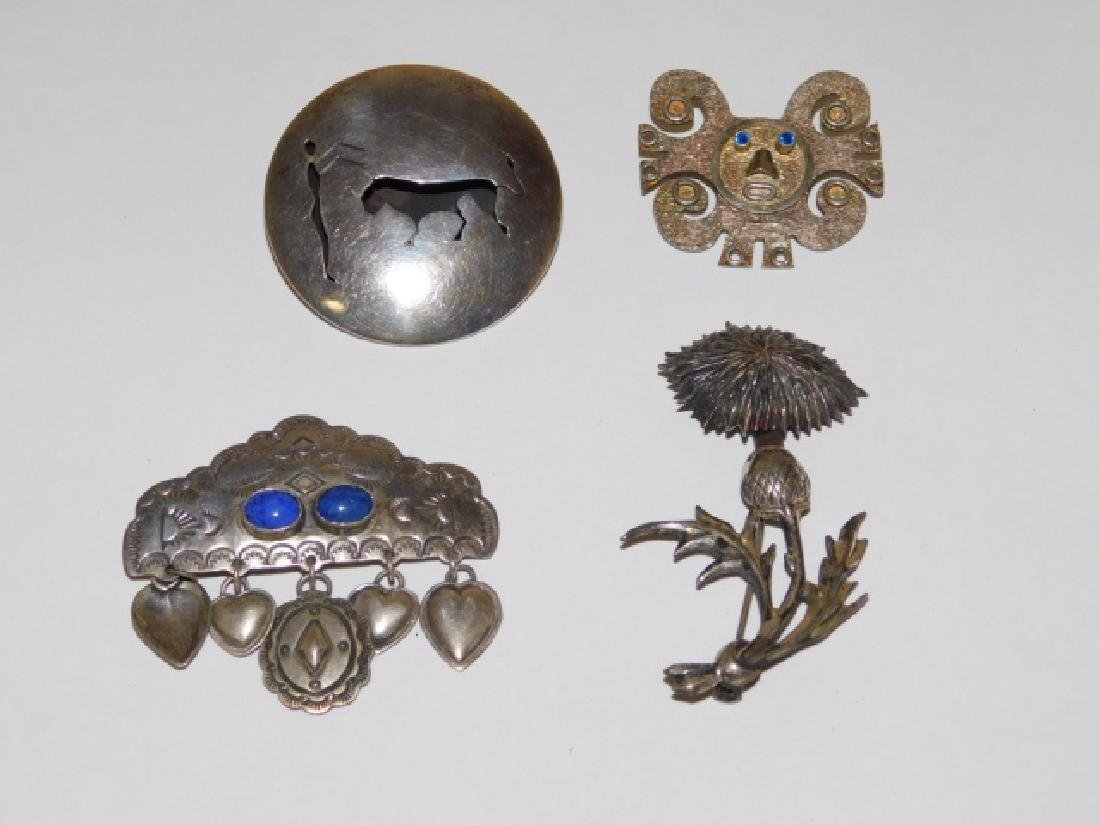 FOUR STERLING SILVER PINS