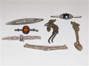 SEVEN STERLING SILVER PINS
