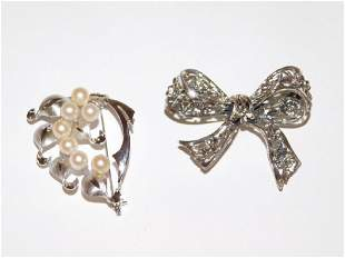TWO STERLING SILVER PINS