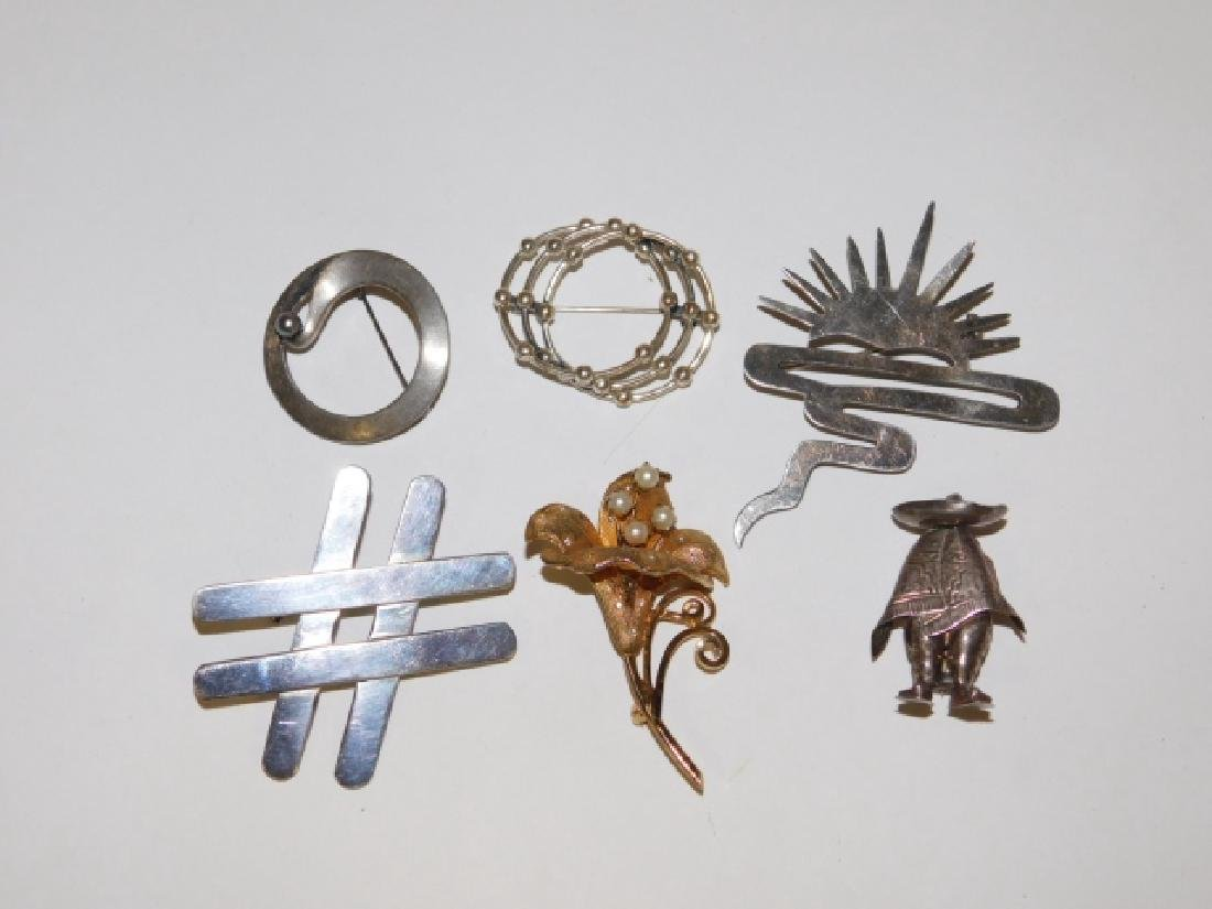 SIX STERLING SILVER PINS