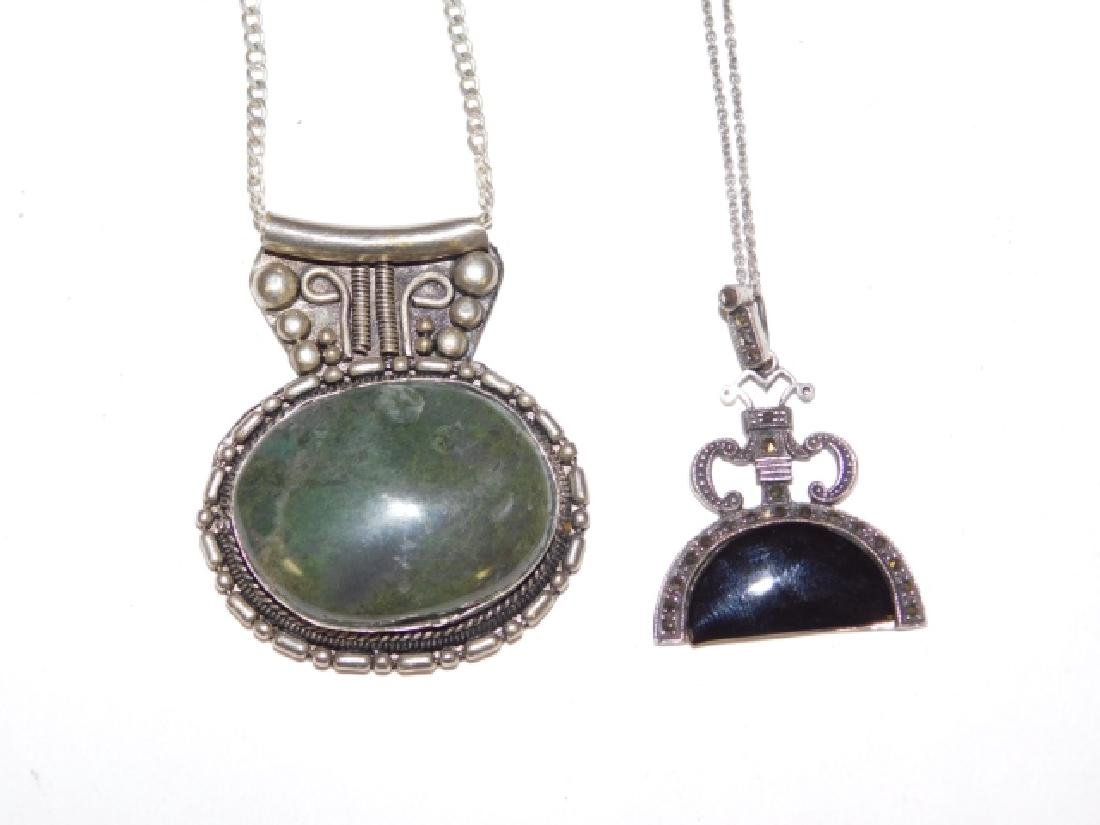 TWO STERLING SILVER PENDANTS ON CHAINS