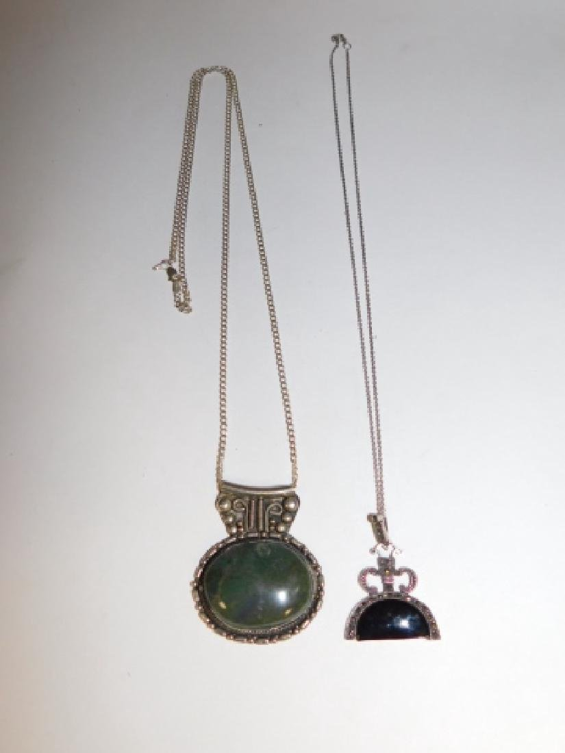TWO STERLING SILVER PENDANTS ON CHAINS - 2