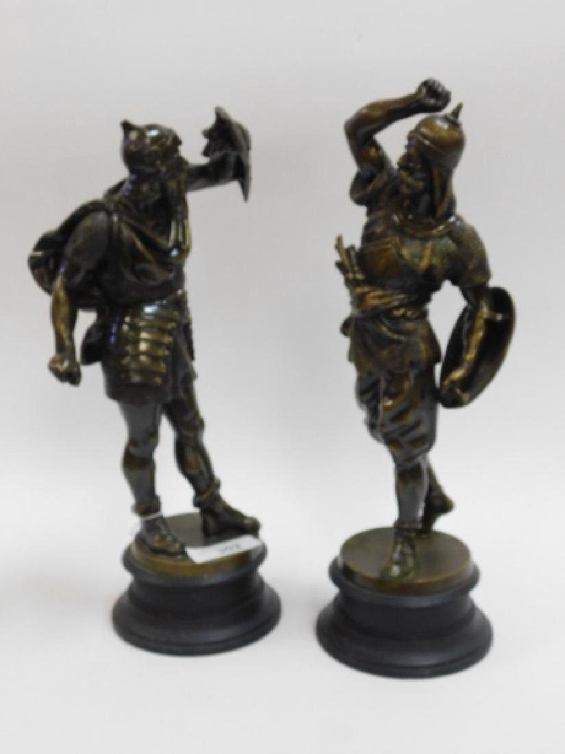 PAIR OF METAL STATUES AND WOOD BASE
