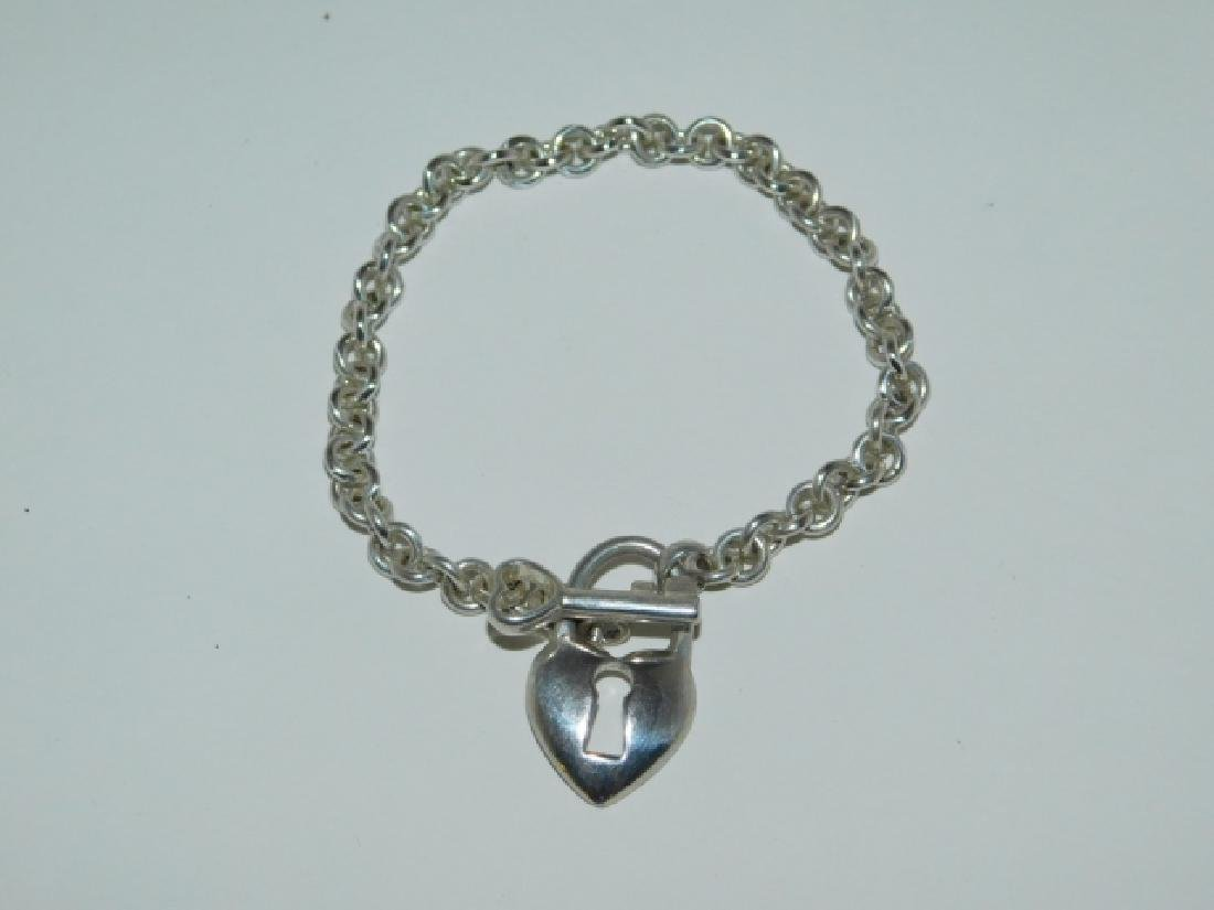 STERLING SILVER LOCKET BRACELET