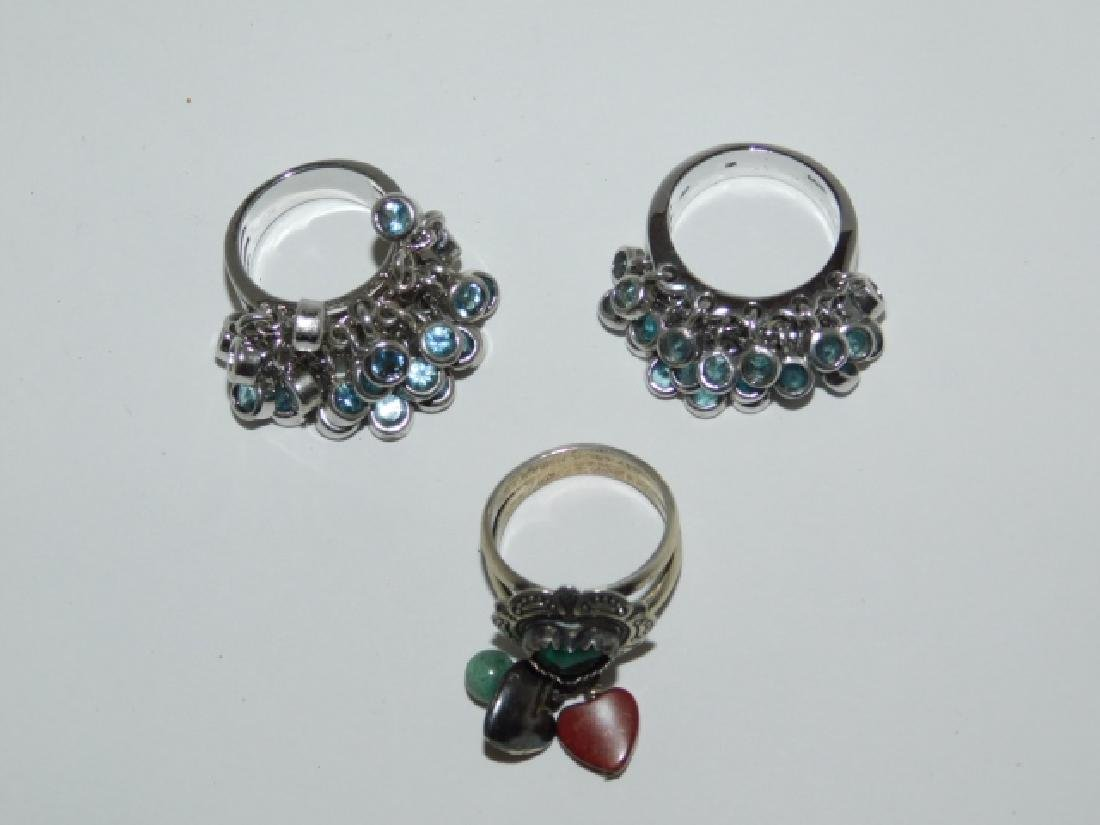 THREE STERLING SILVER DANGLY RINGS - 2