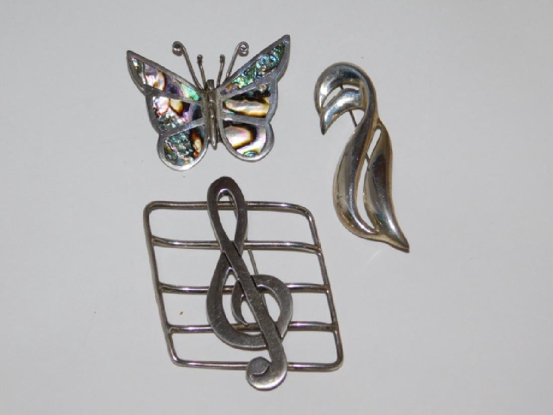 THREE MEXICAN STERLING SILVER PINS