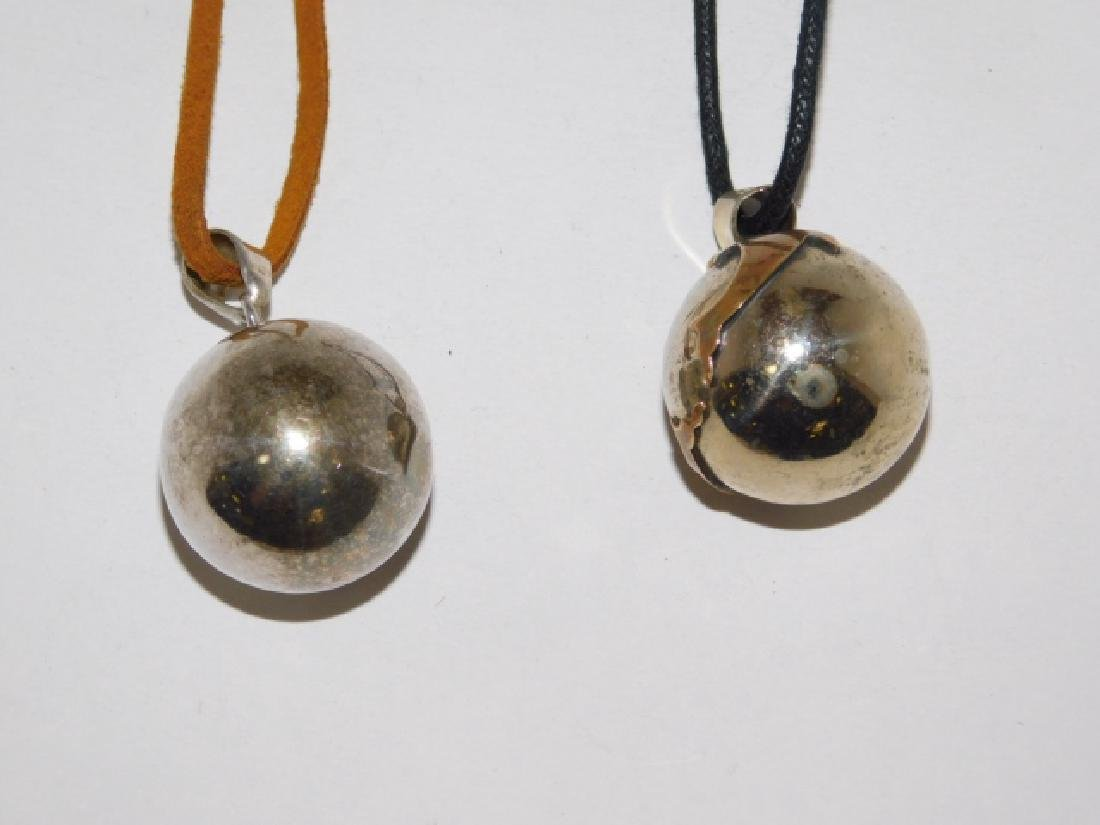 TWO STERLING SILVER CHIME BALL PENDANTS