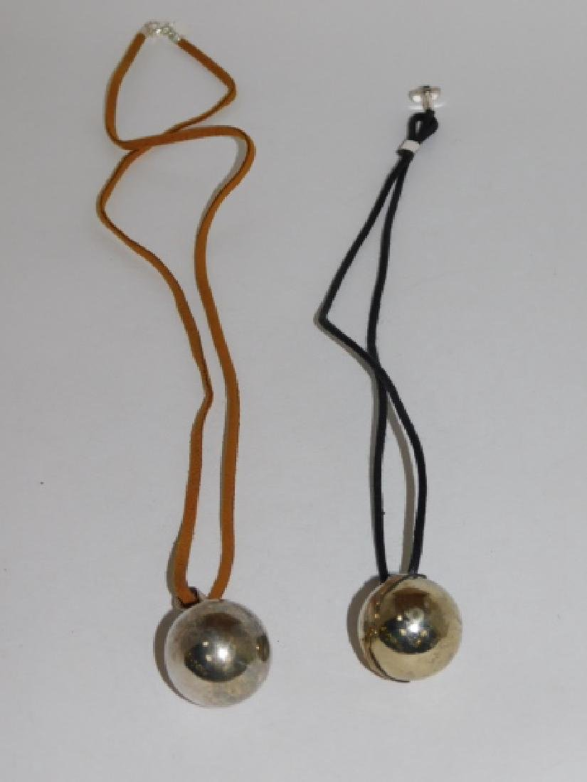 TWO STERLING SILVER CHIME BALL PENDANTS - 2