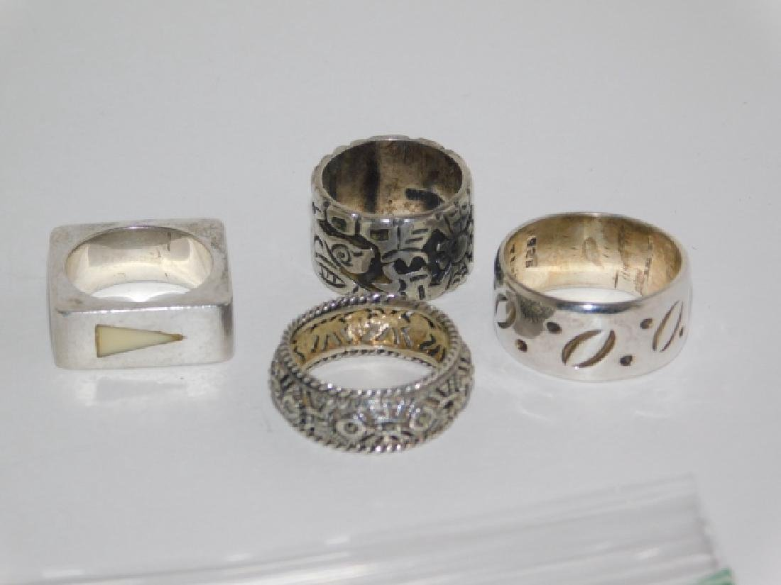 FOUR STERLING SILVER RINGS