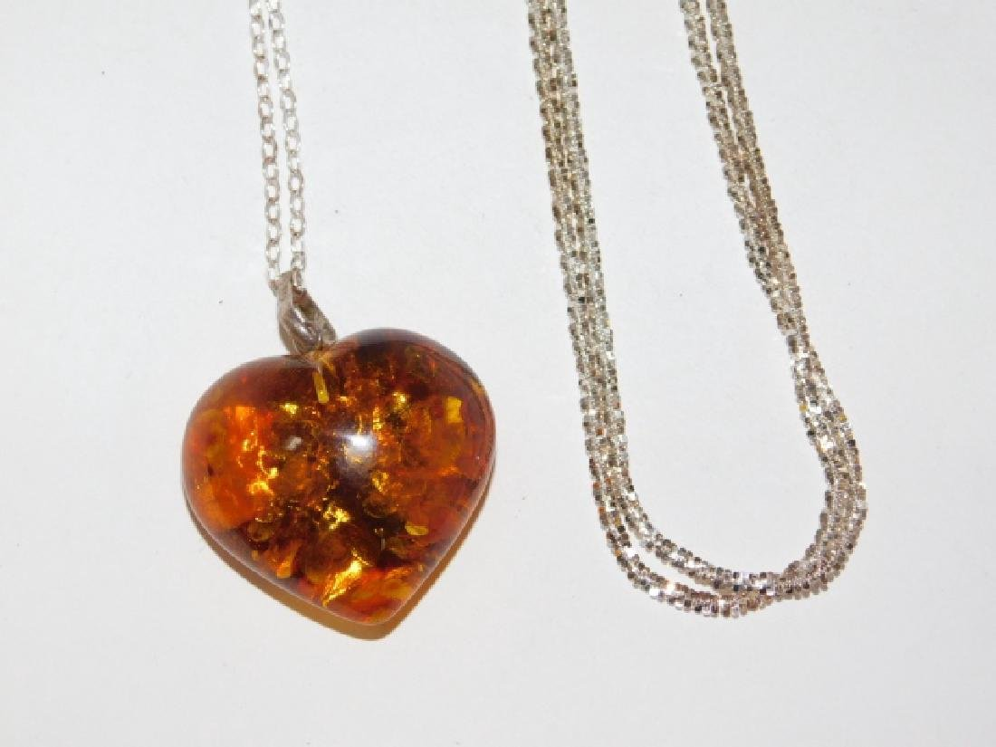 TWO STERLING SILVER CHAINS WITH AMBER PENDANT