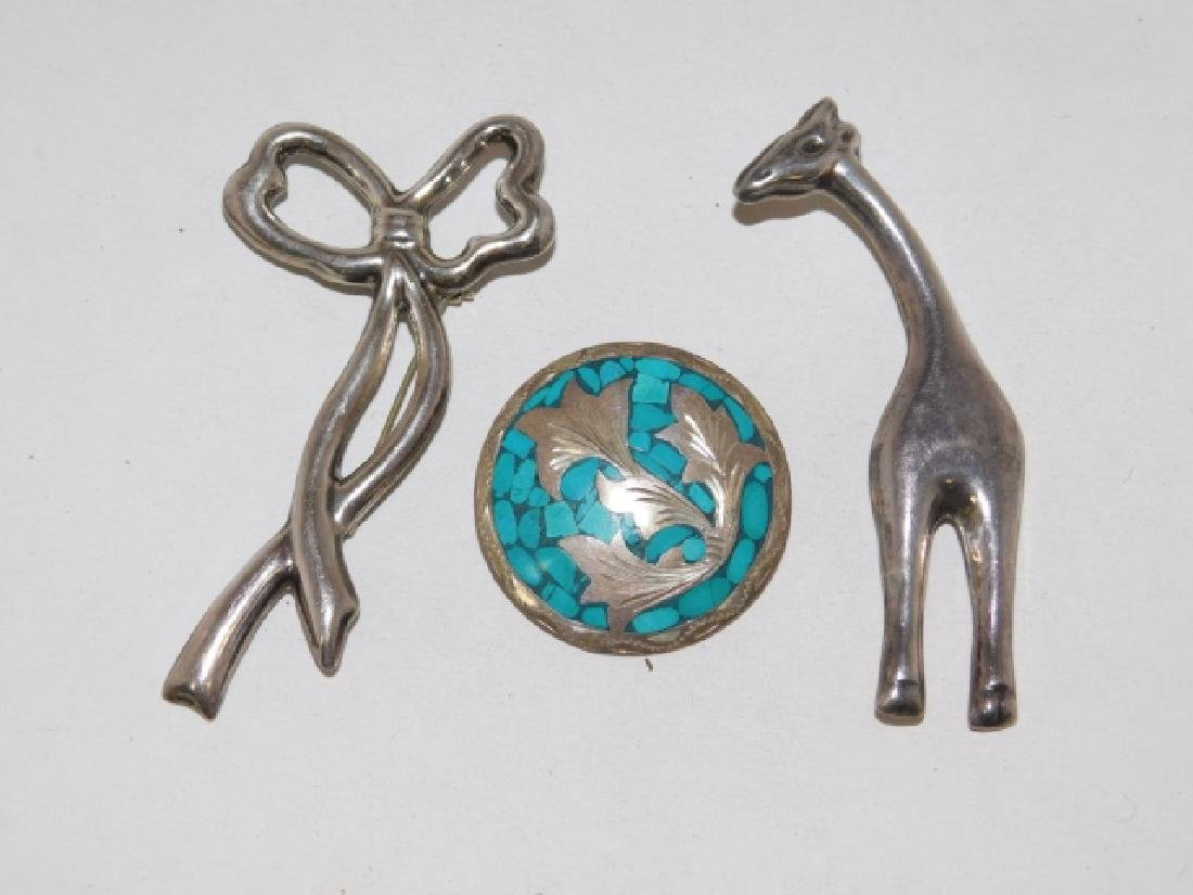 THREE STERLING SILVER PINS