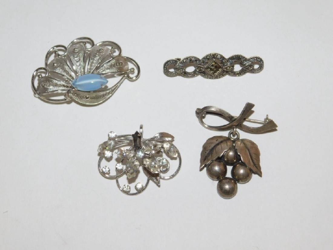 FOUR STERLING SILVER BROOCHES