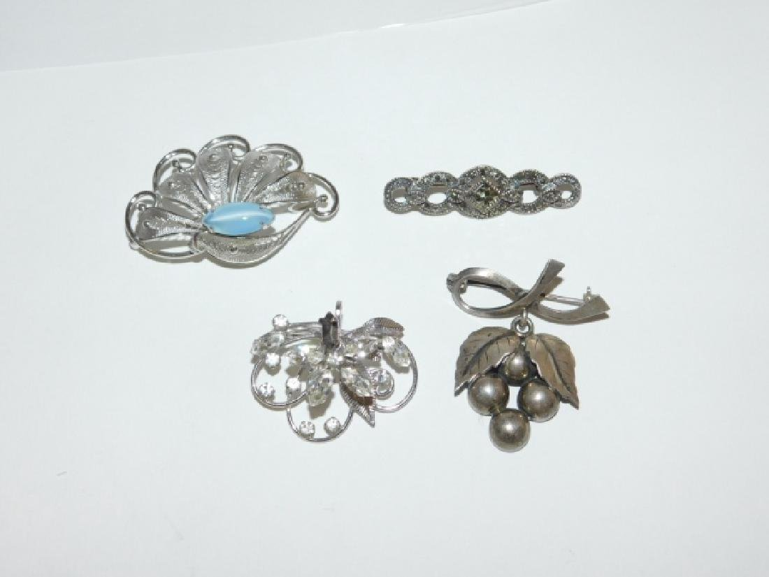 FOUR STERLING SILVER BROOCHES - 2