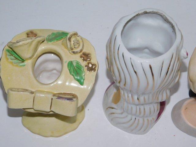 FOUR HEAD VASES - 6