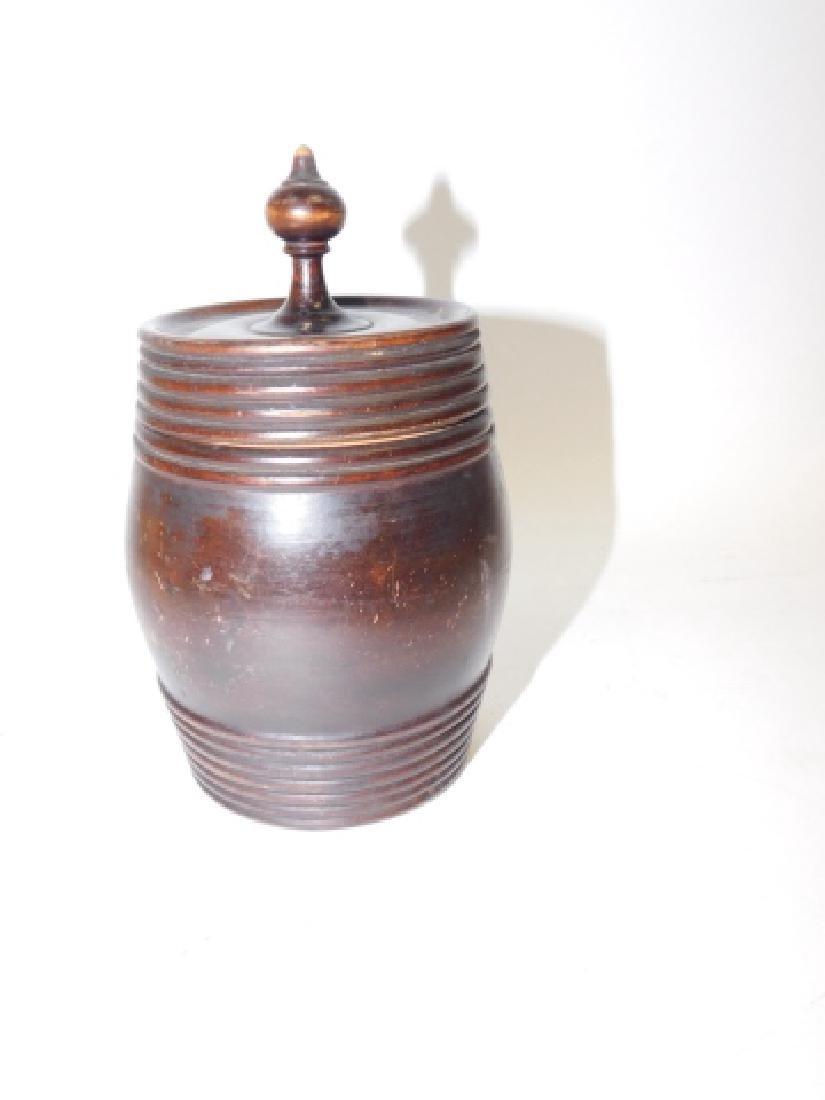 WOOD CARVED COVERED BARREL JAR