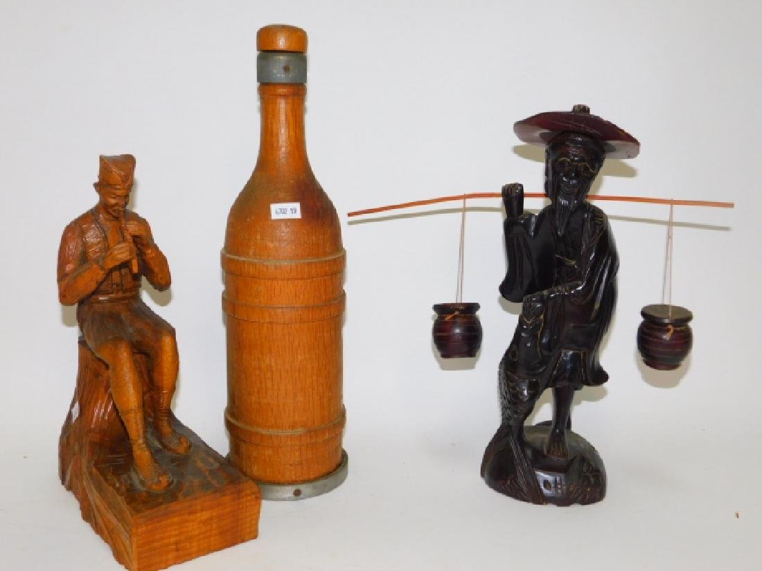 WOOD CARVED FIGURES AND BOTTLE.
