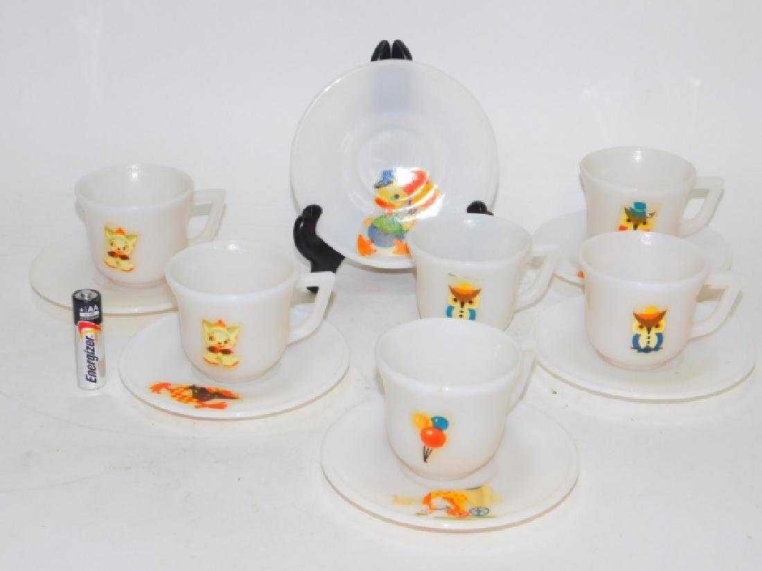 SET OF SIX CHILDREN'S TEA CUPS AND SAUCERS