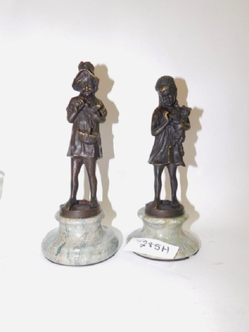 PAIR OF METAL STATUES ON MARBLE BASE