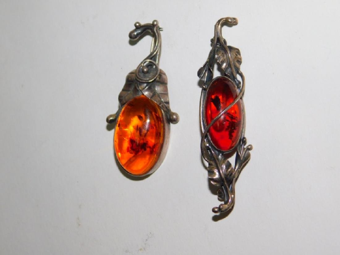 TWO STERLING SILVER WITH AMBER STONE PINS