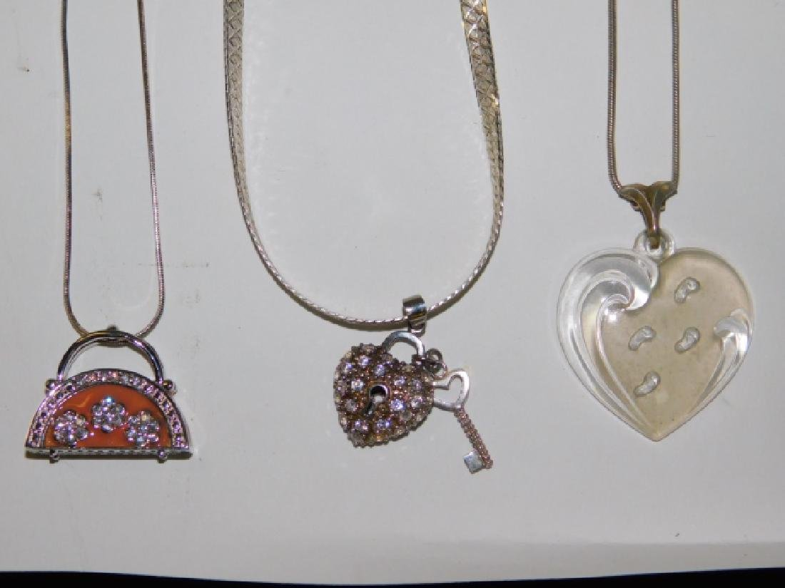 THREE STERLING SILVER NECKLACES WITH PENDANTS