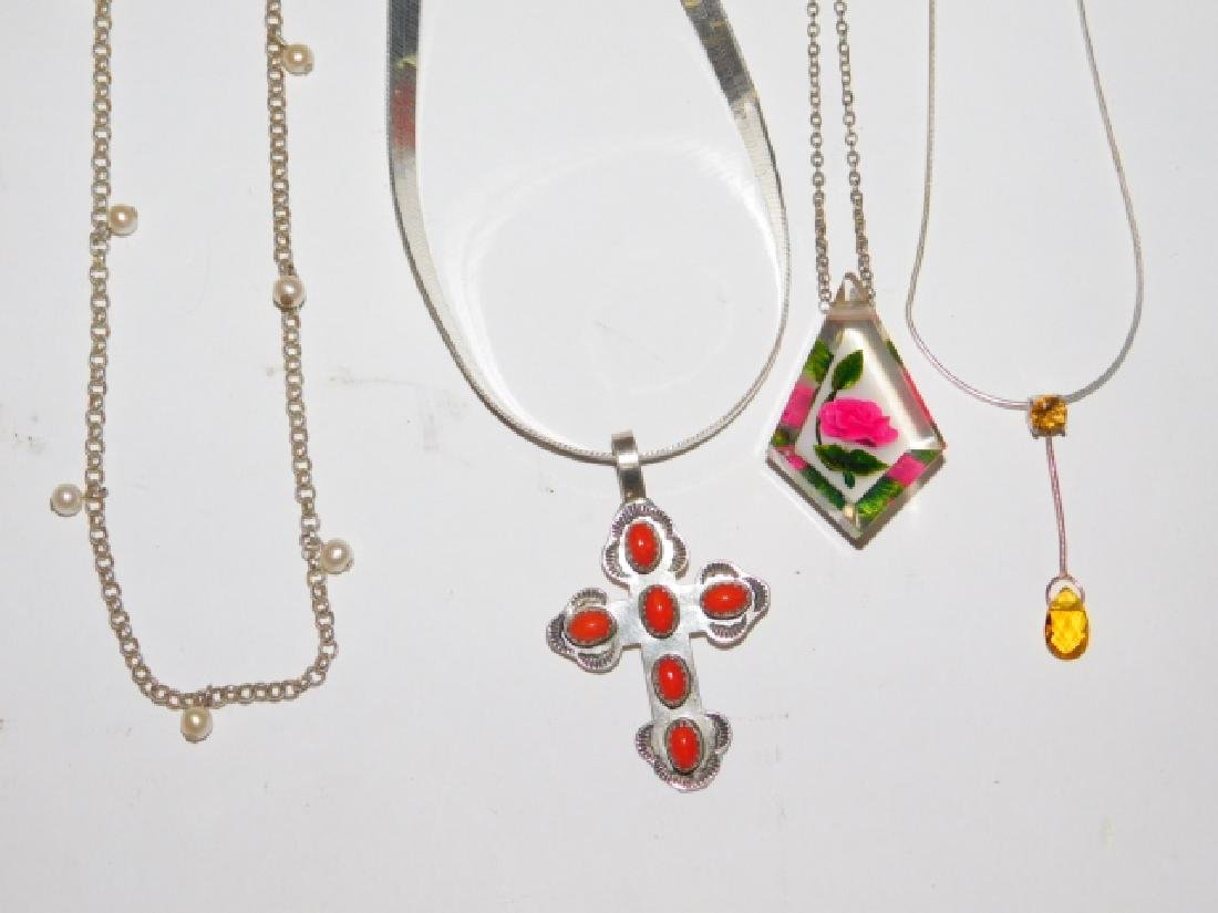 FOUR STERLING SILVER NECKLACES