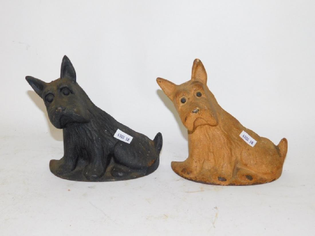 TWO CAST IRON DOG DOOR STOPS