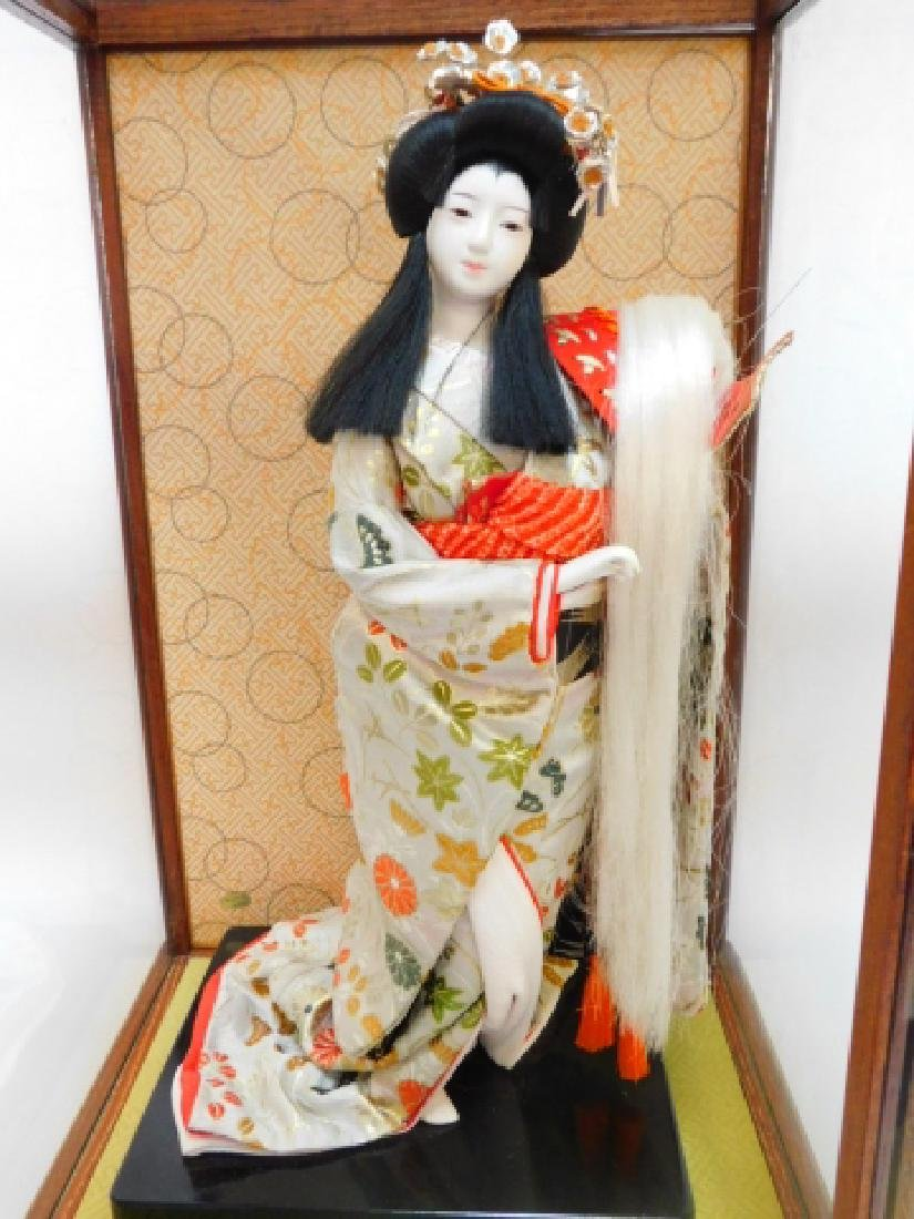 PORCELAIN ORIENTAL DOLL WITH GLASS CASE
