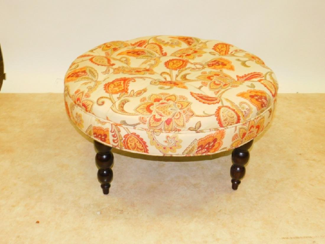 UPHOLSTERED ROUND OTTOMAN