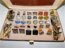 COLLECTION OF CUFFLINKS AND TIE CLIPS WITH BOX