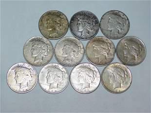 11 LIBERTY SILVER DOLLARS