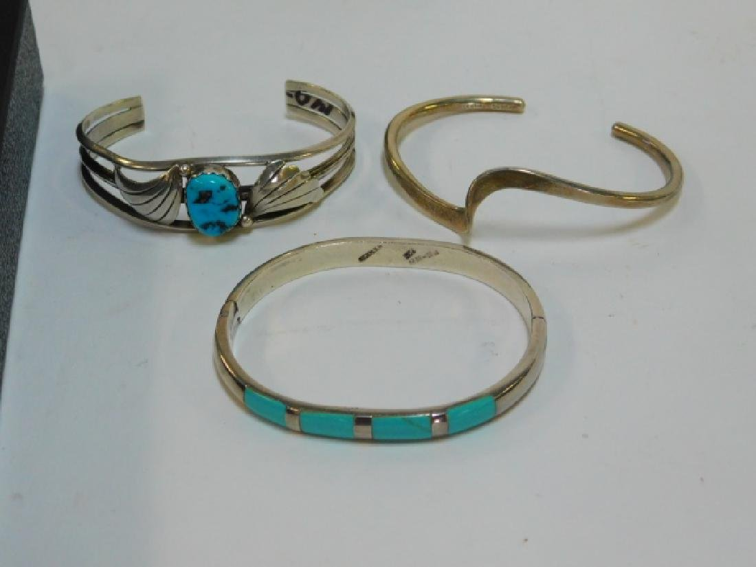 THREE STERLING SILVER BRACELETS