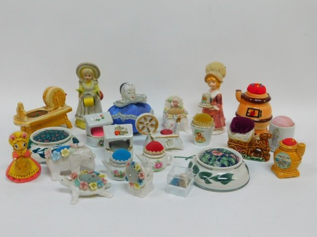 COLLECTION OF PORCELAIN PIN CUSHIONS