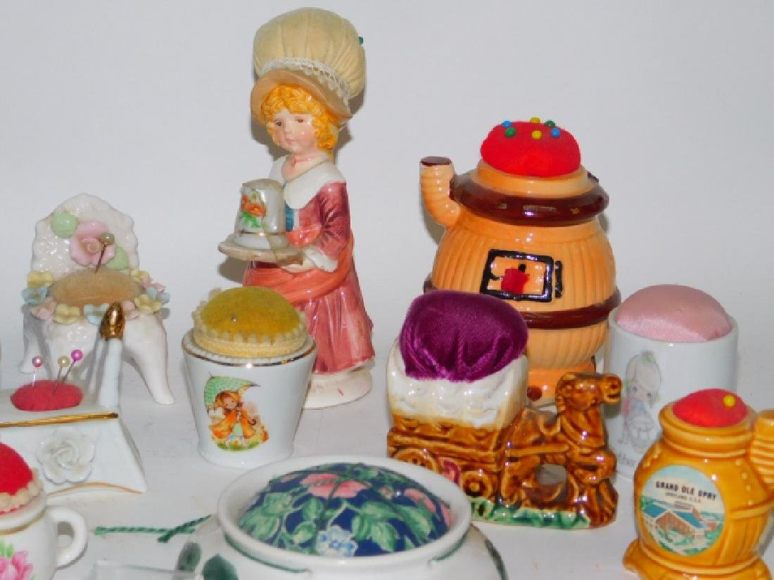 COLLECTION OF PORCELAIN PIN CUSHIONS - 2