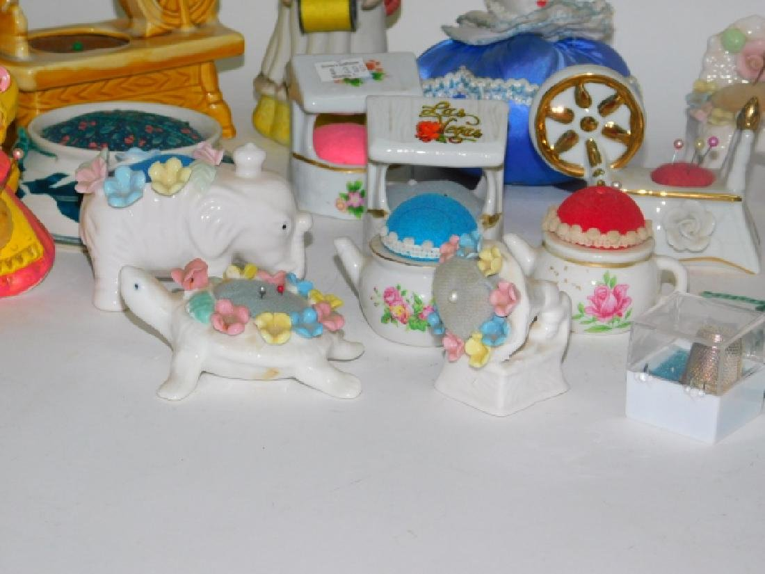 COLLECTION OF PORCELAIN PIN CUSHIONS - 3