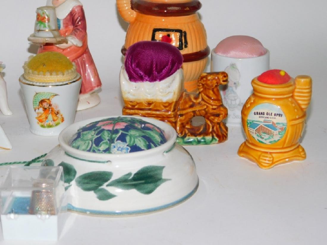 COLLECTION OF PORCELAIN PIN CUSHIONS - 4
