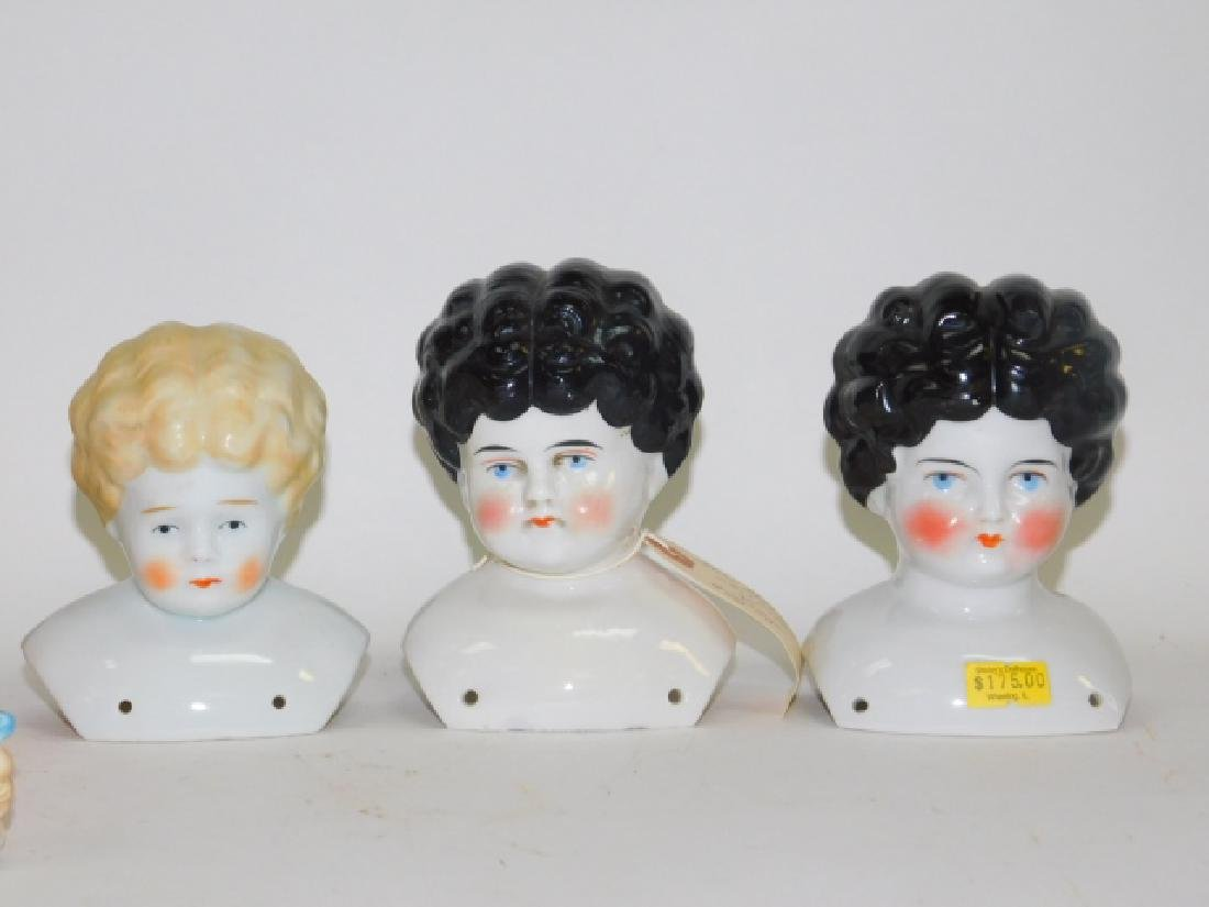 COLLECTION OF PORCELAIN DOLL HEADS - 3