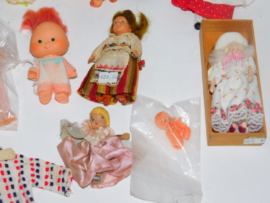 COLLECTION OF PORCELAIN, CLOTH, AND PLASTIC DOLLS - 3
