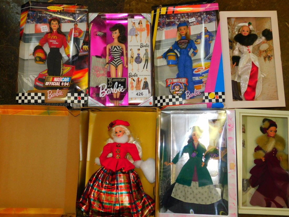 SEVEN BARBIE DOLLS