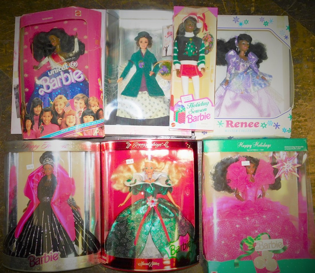 SEVEN BARBIE DOLLS.