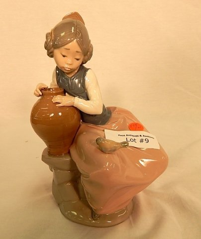LLADRO SITITNG GIRL WITH POT AND BIRD
