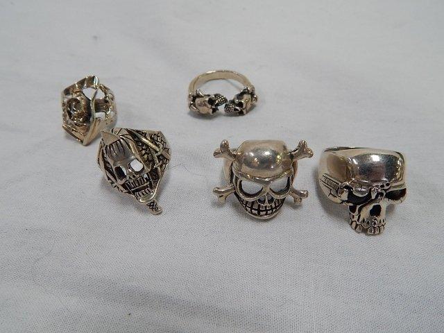 FIVE  STERLING SILVER SKULL RINGS