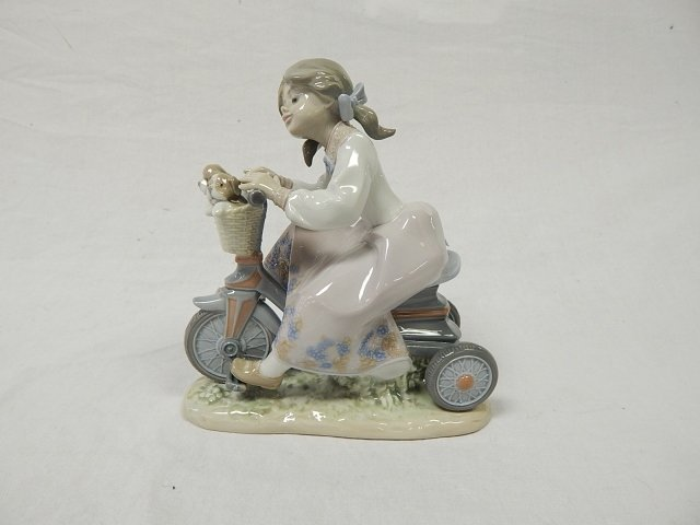 LLADRO GIRL ON A BIKE WITH PUPPIES